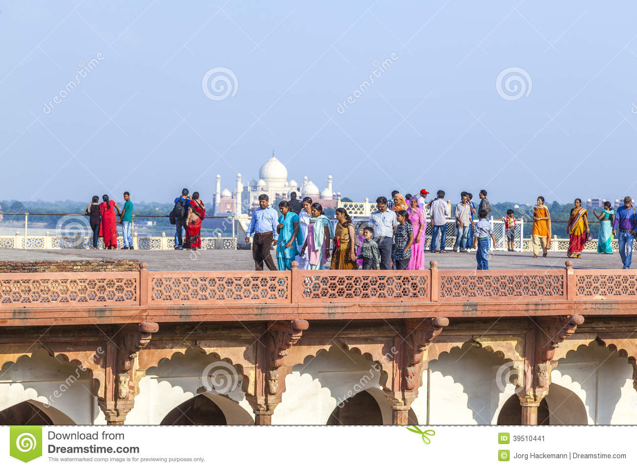 Tourists in the Red Fort in Agra with the Taj Mahal in the background