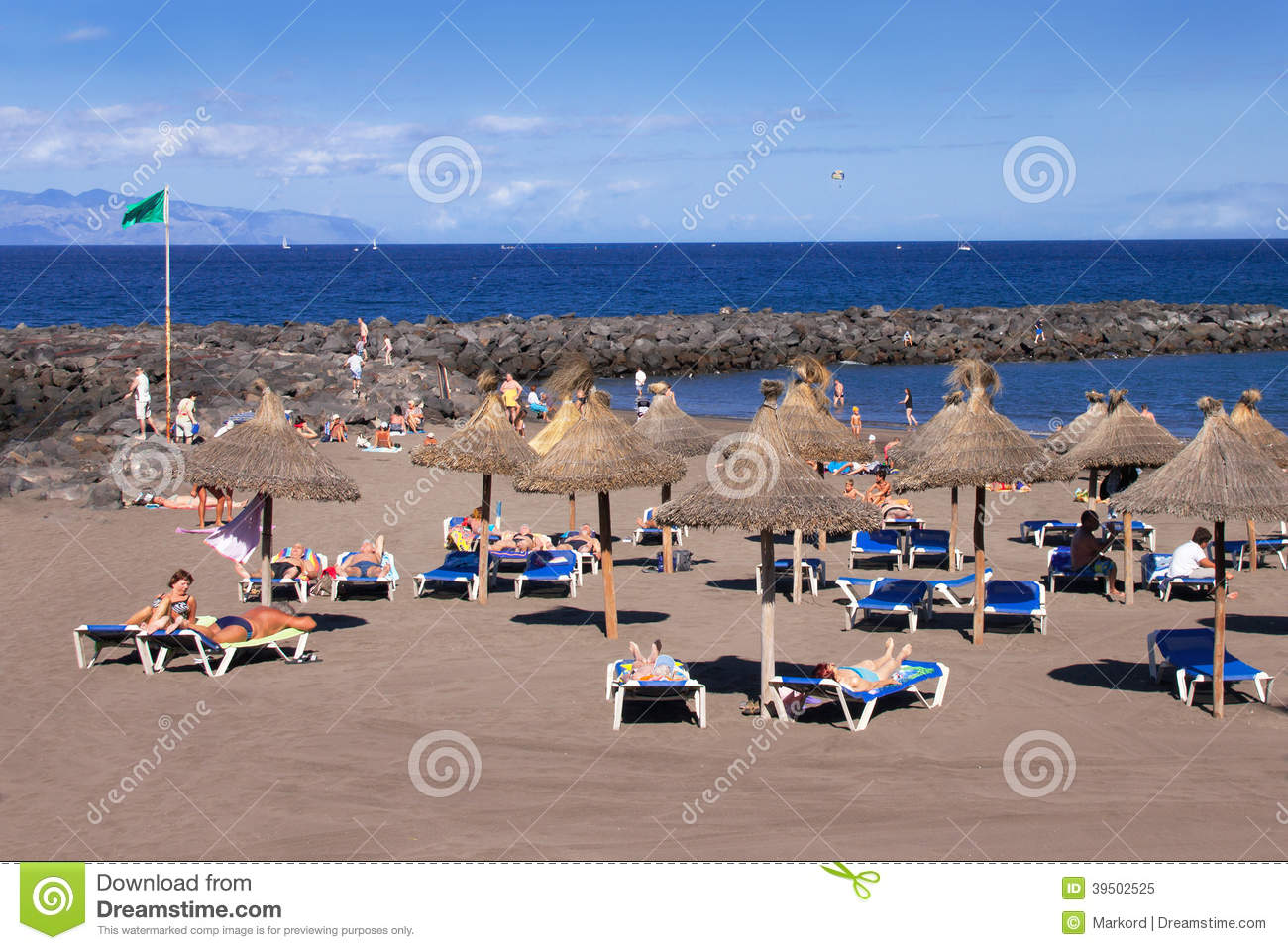 Tourists are resting at the sand beach.