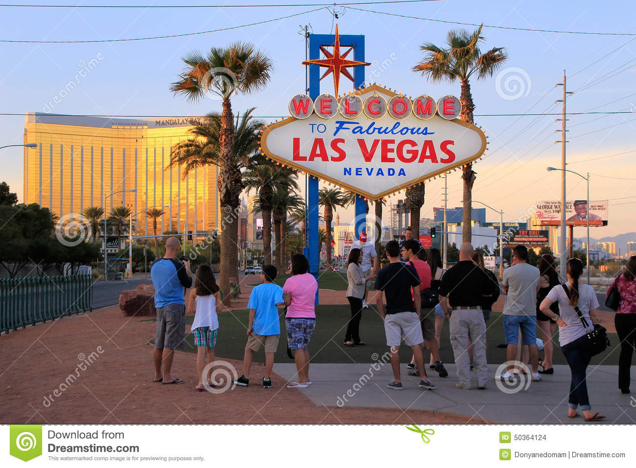 tourists standing by welcome to fabulous las vegas sign nevada editorial stock image image of. Black Bedroom Furniture Sets. Home Design Ideas