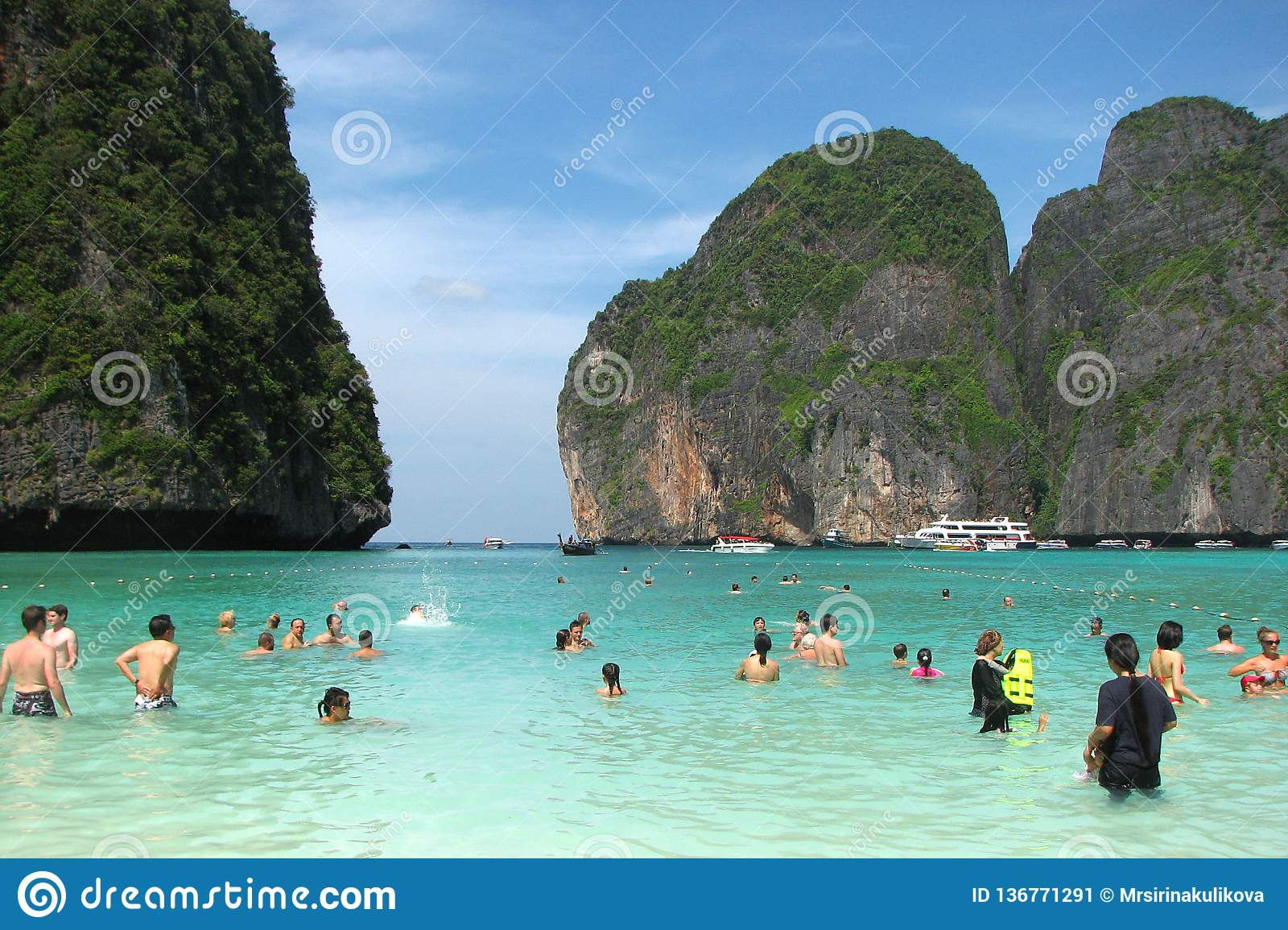 Tourists and tourist boats on the famous beach in Maya Bay on one of the islands of Phi Phi, Thailand