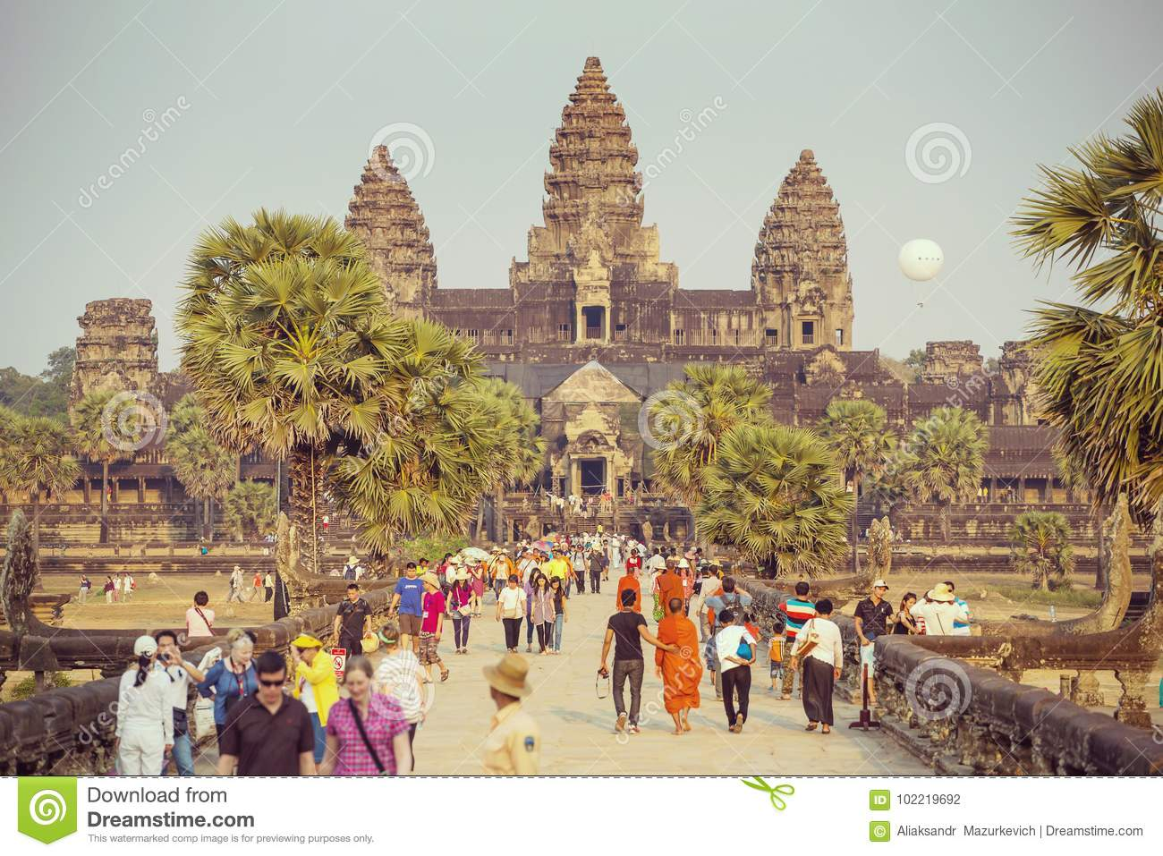 Download Tourists Visit The Historic Angkor Wat Temple Complex Editorial Photography - Image of color, complex: 102219692