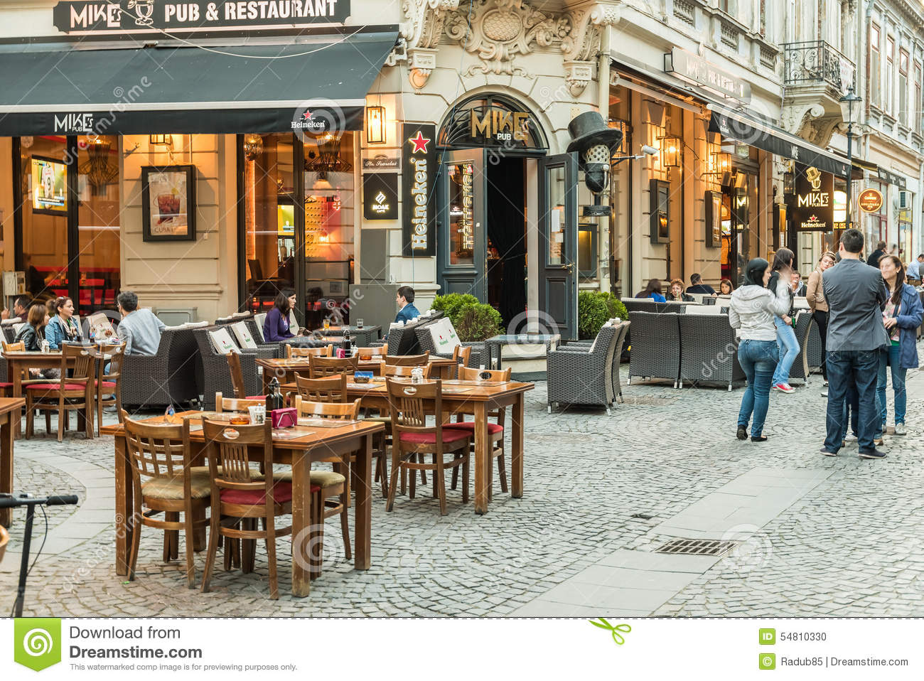 Tourists Visiting And Having Lunch At Outdoor Restaurant Cafe Downtown In Bucharest Editorial