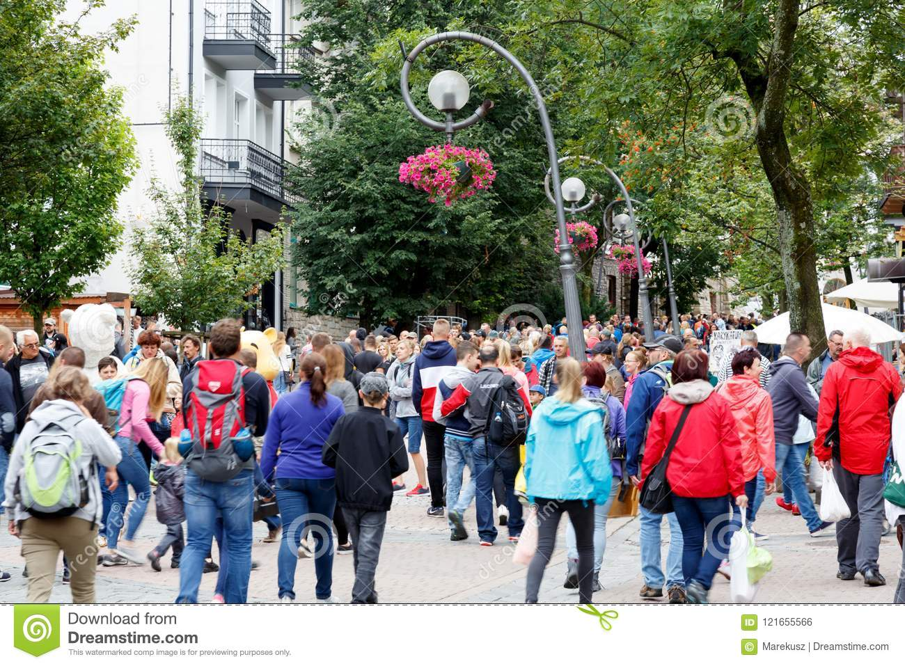 Tourists walk along Krupowki Street