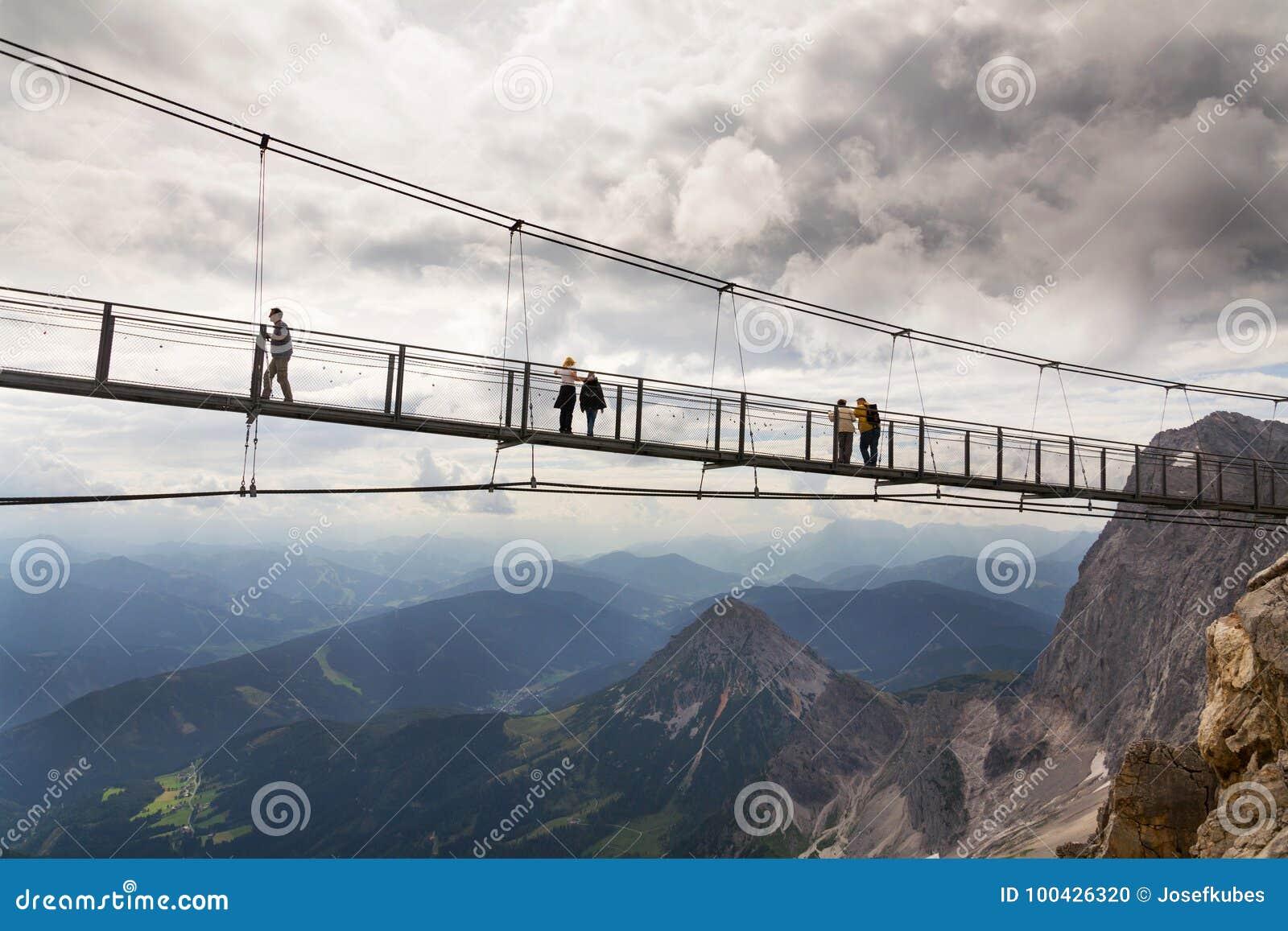 Tourists Walk on the Austrias Highest Suspension Bridge in ...
