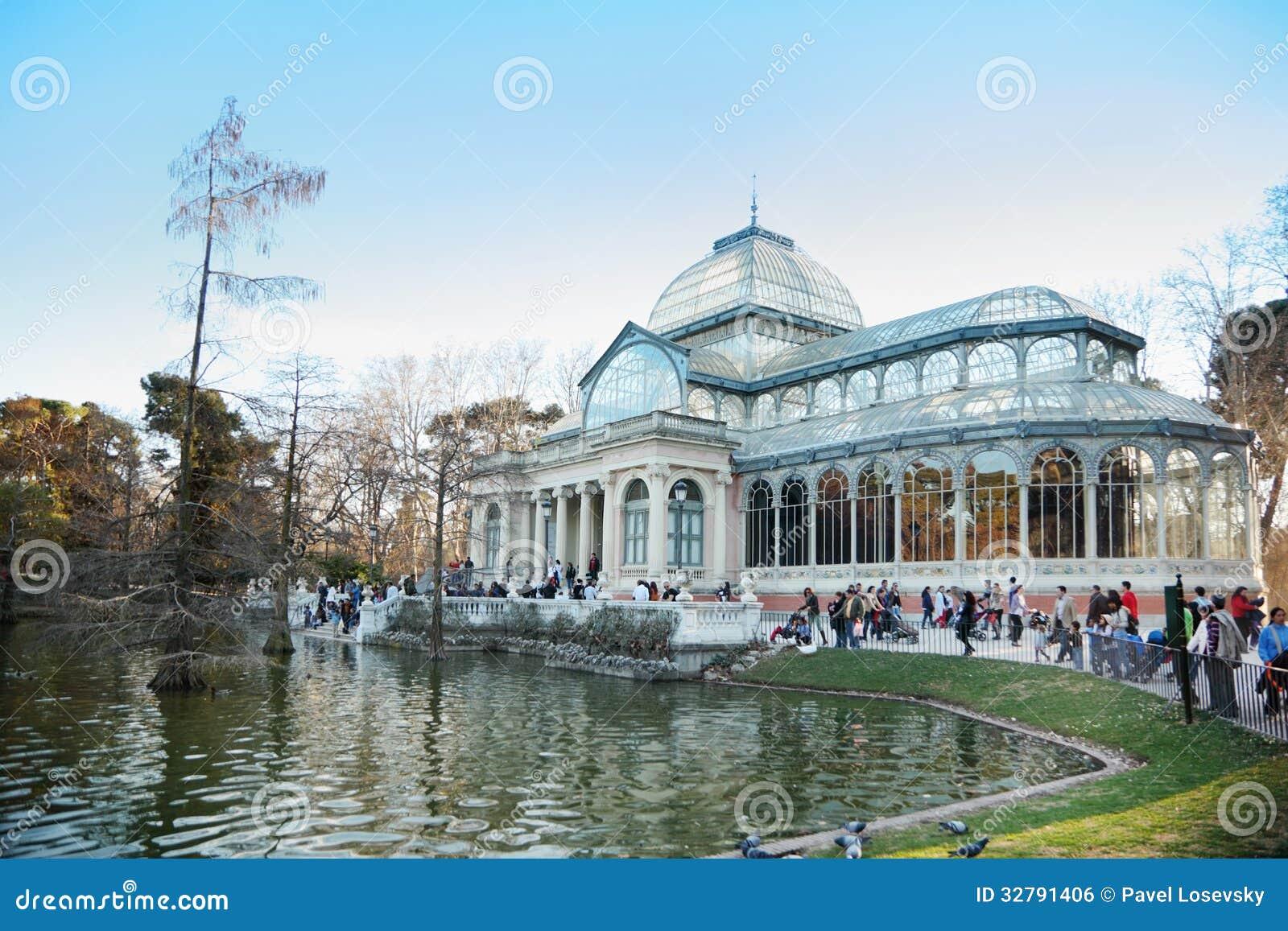 tourists walk near pond and glass pavilion editorial photo image