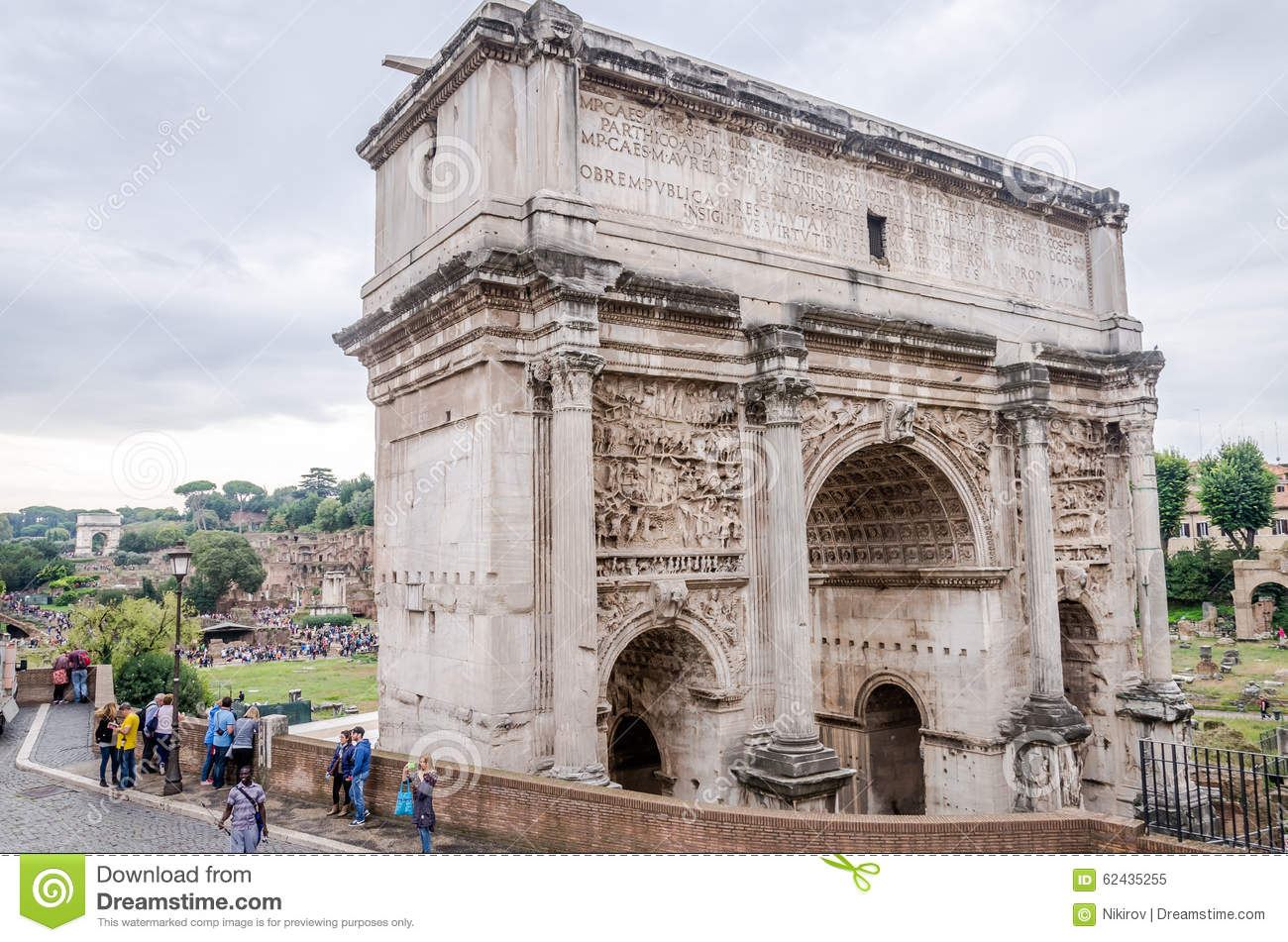 Tourists walk and take pictures in the photo on the tour of the ancient ruins of the ancient imperial capital of the Roman Forum a