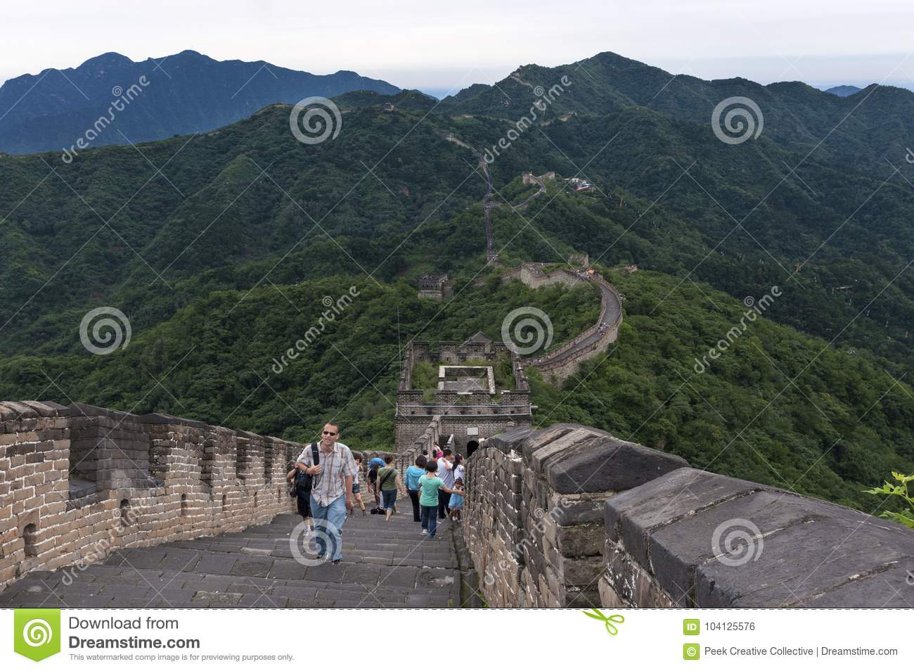 Tourists walking along a section of the Great Wall of China in Mutianyu, Chin