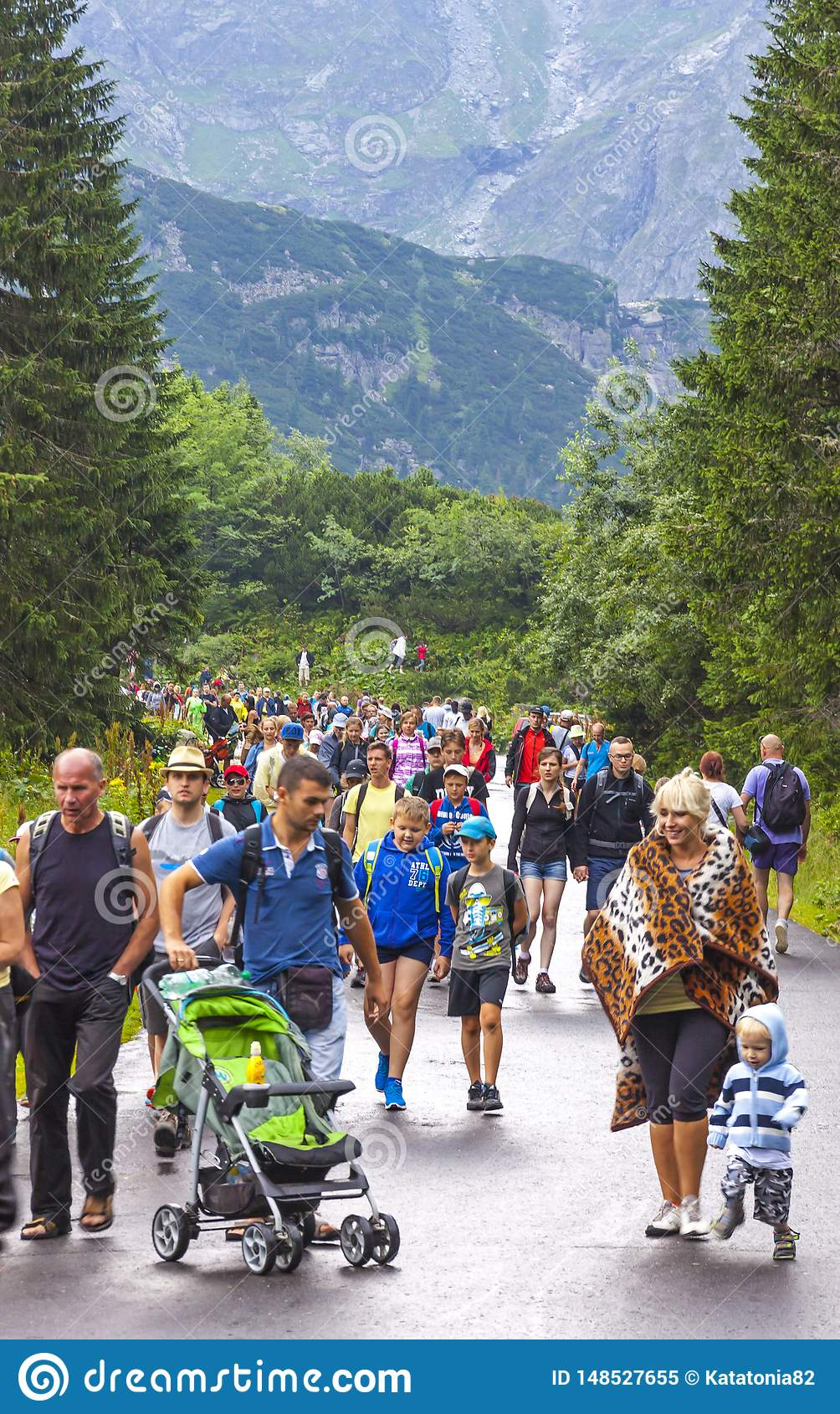 Tourists walking on road to Morskie Oko lake in High Tatras, Poland