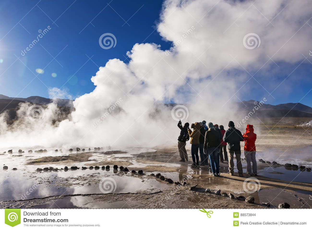 One buddy watching the geyser never