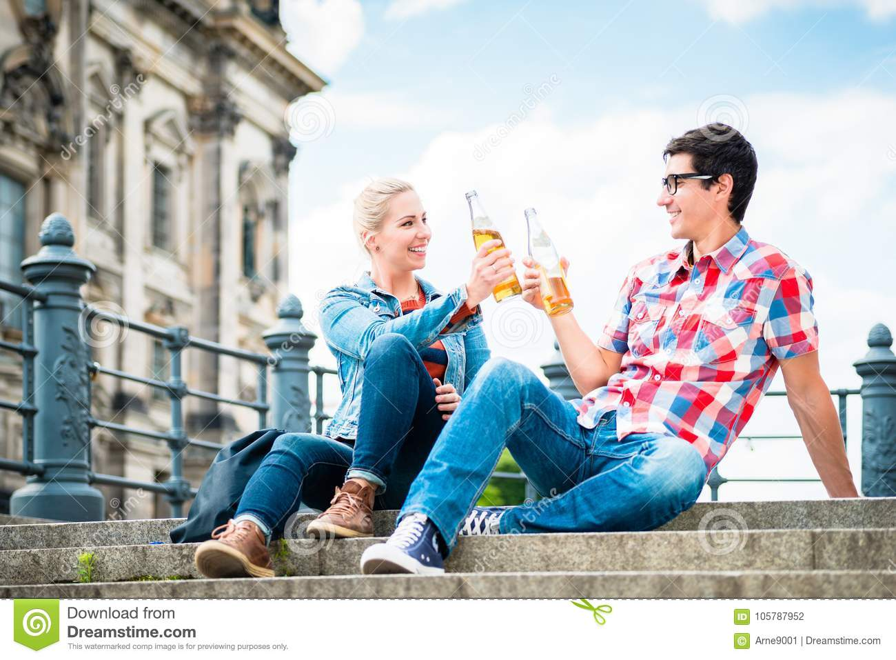 Berlin tourists enjoying view from Museum Island with beer