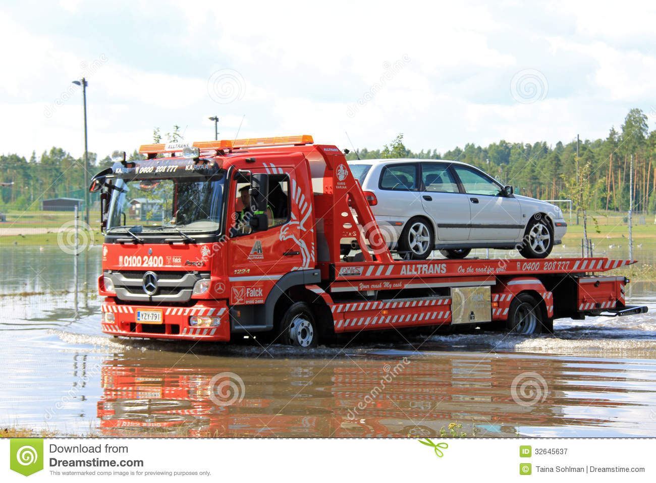 Tow Truck Rescuing Car From Flood Editorial Photography