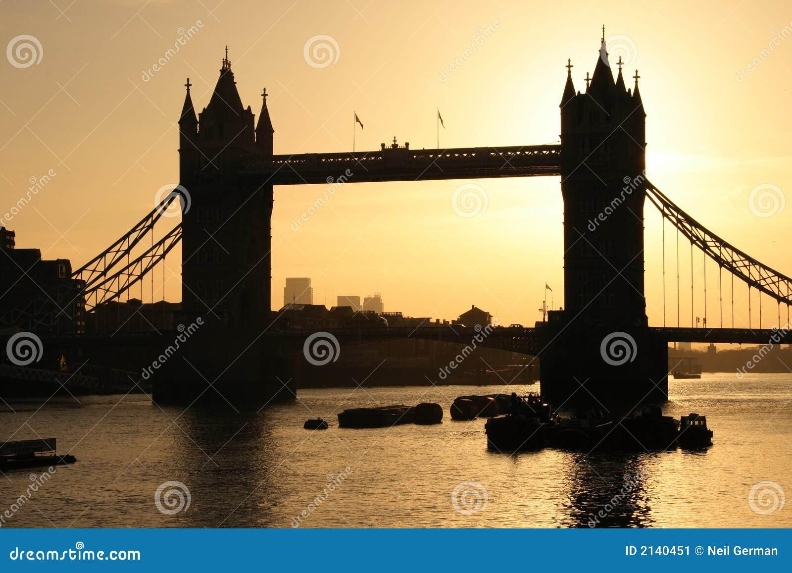 Dawn sunrise silhouette of tower bridge in london crossing over