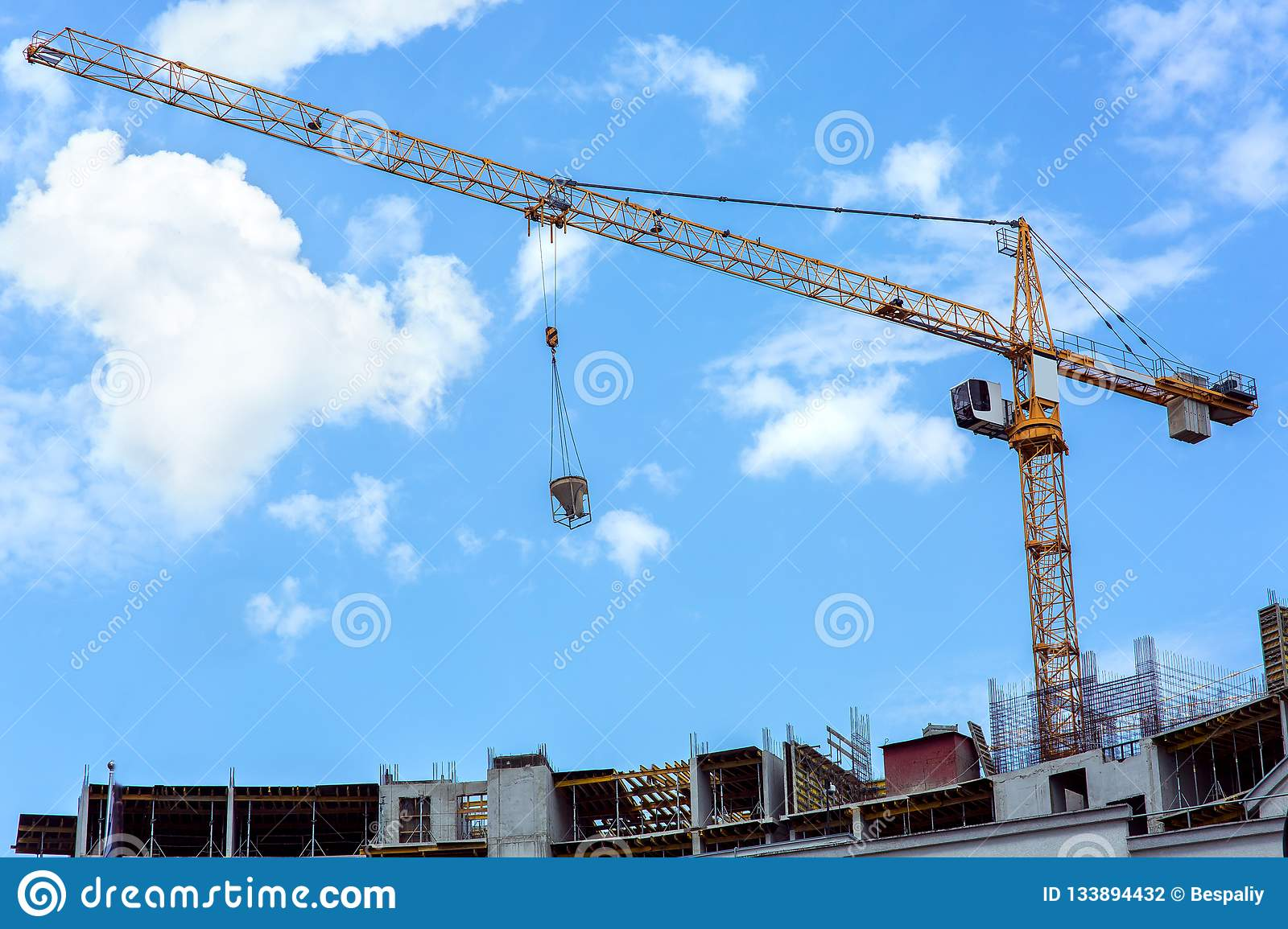The Tower Crane Lifts The Tank With Concrete  Stock Photo