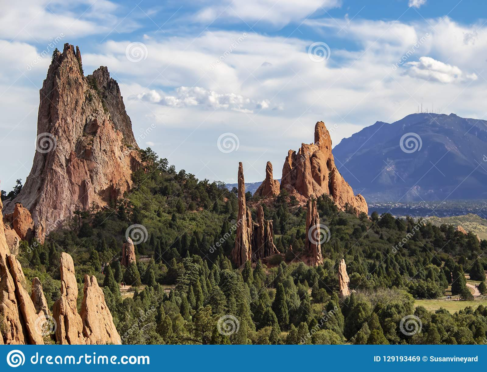 The towering red rock formations of the Garden of the Gods of Colorado Springs with Cheyenne Mountain in the background