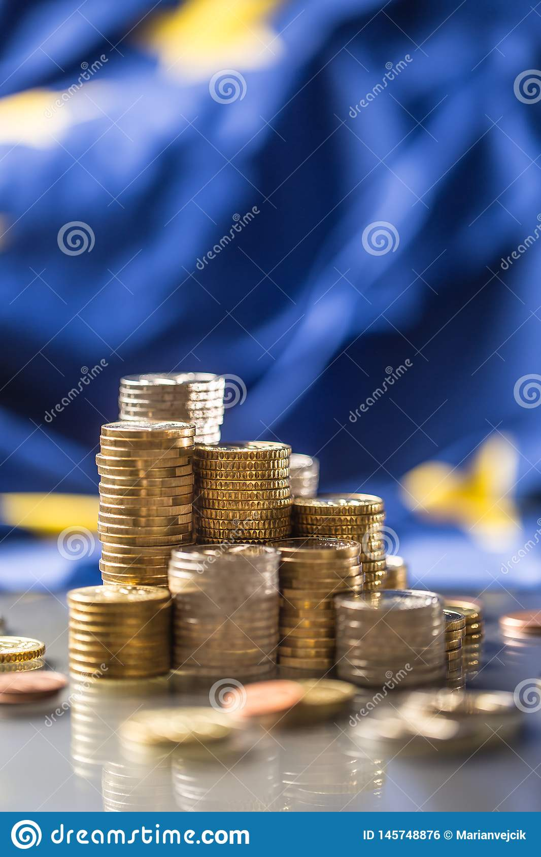 Towers with euro coins and flag of European Union in the background