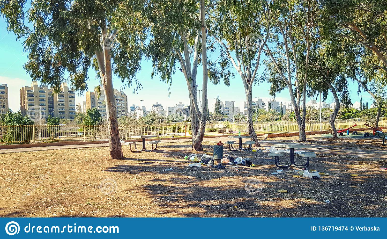 A small town park provides neighborhood dwellers with picnic facilities