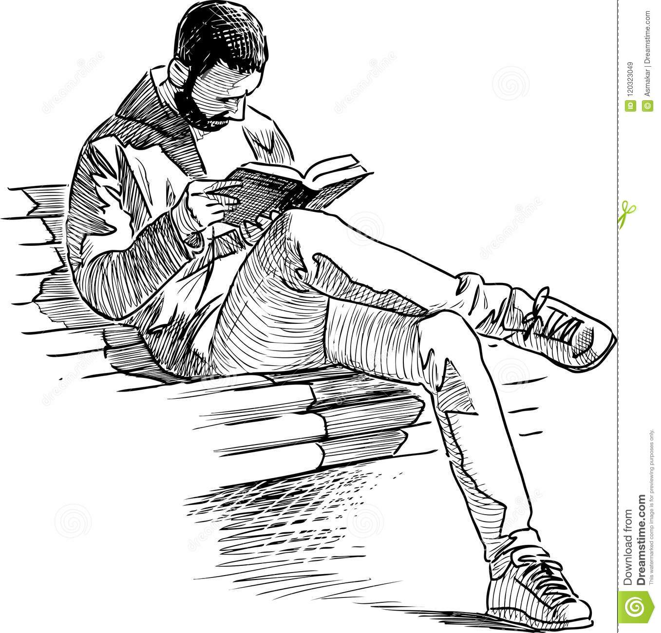A townsman reads a book in a city park