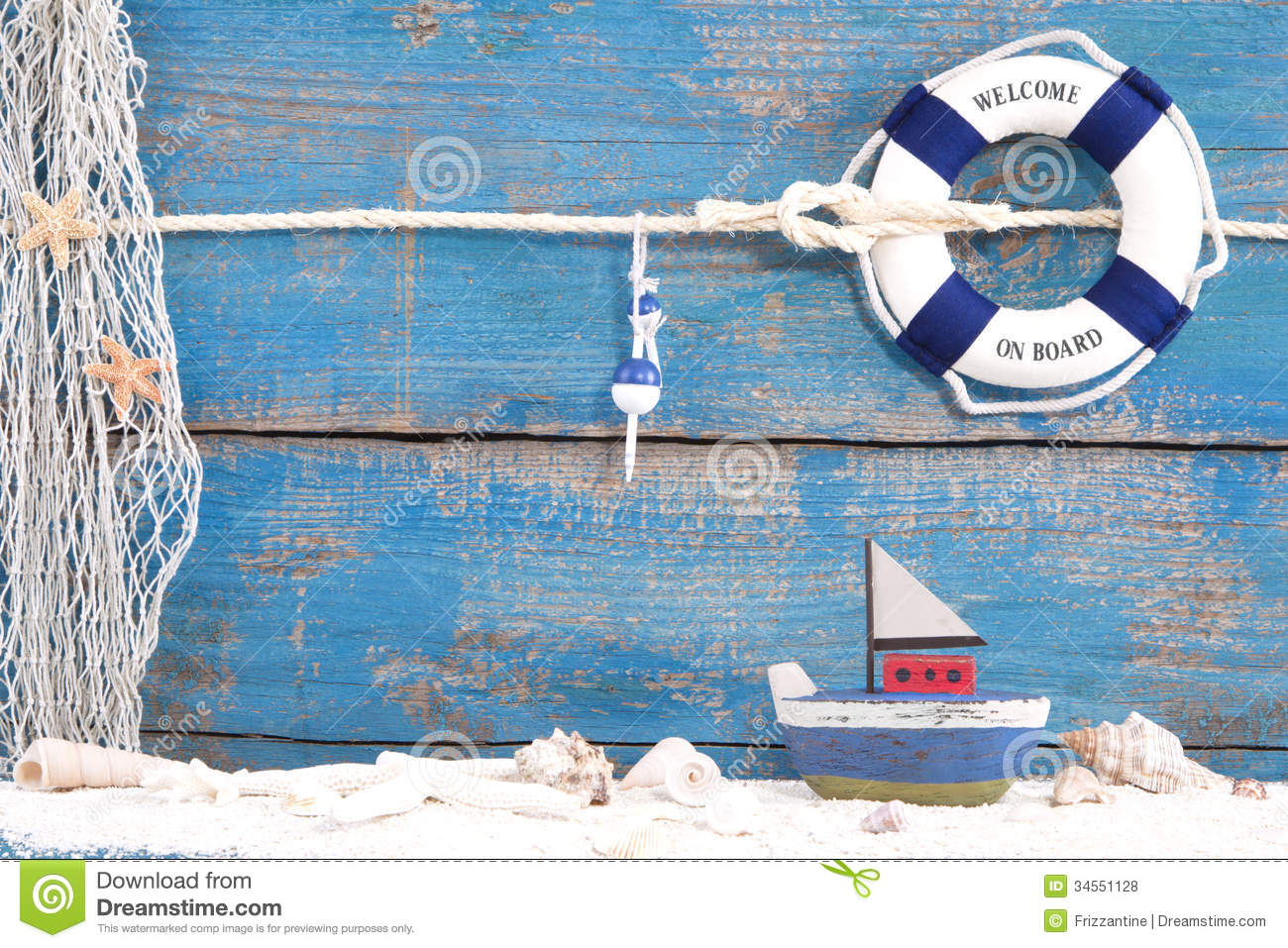 Toy boat with shells on a blue wooden background forsailing, summer ...