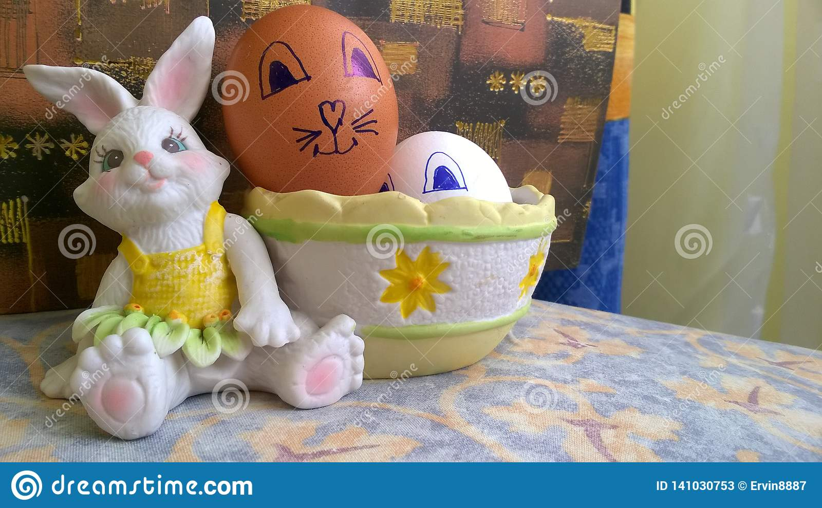 Toy bunny with basket and easter eggs