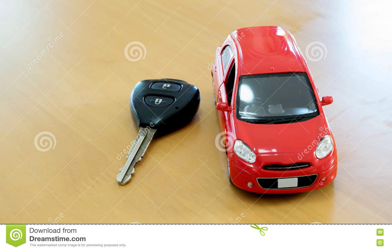 Toy car and keys over white. Rent or buy car