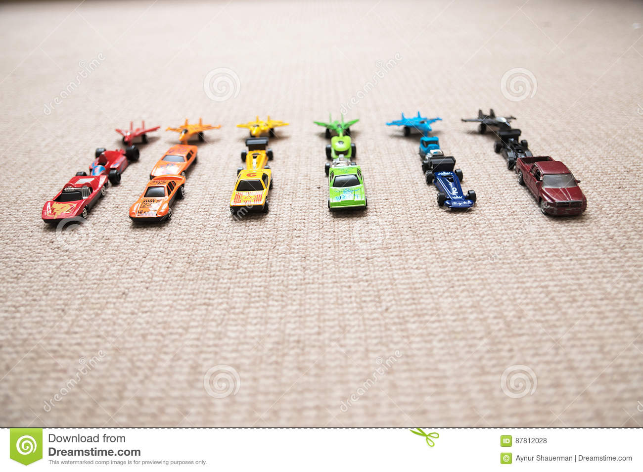 Toys For Boys To Color : Toy cars collection on carpet.sorted by color. transportation