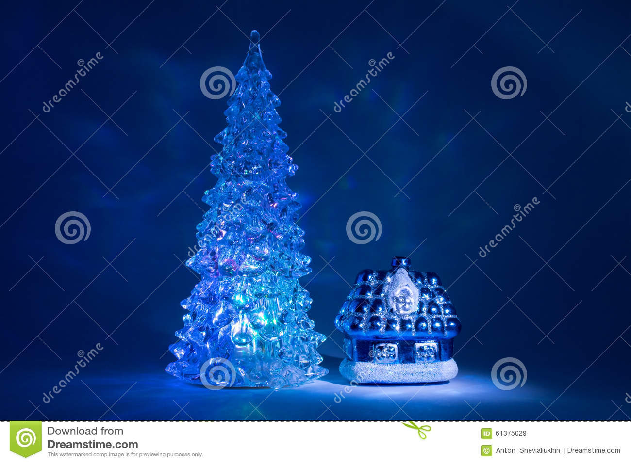toy christmas tree shining with beautiful shadows northern lights near the house from a fairy tale on a dark blue background stock photo 61375029 megapixl