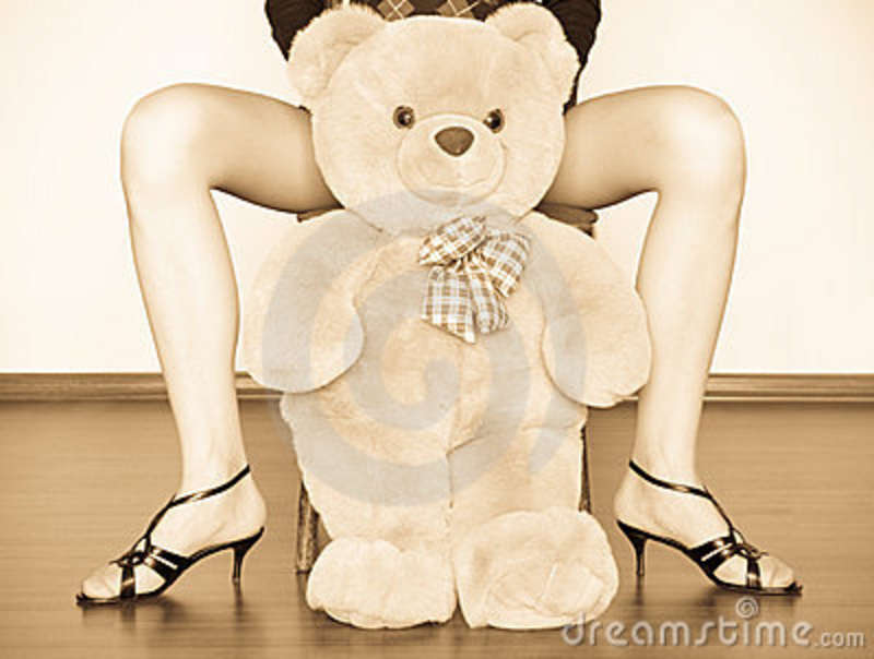Toys For Legs : Toy between girl legs stock image