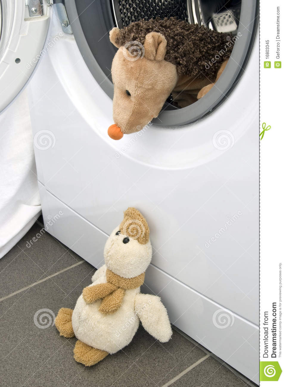 Toy Hedgehog In Washing Machine With Duck Royalty Free