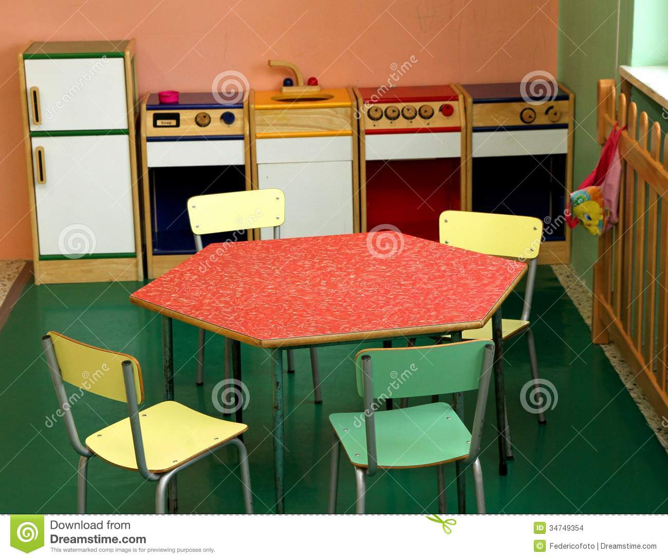 Toy kitchen and chairs to play in a nursery stock images for Play kitchen table