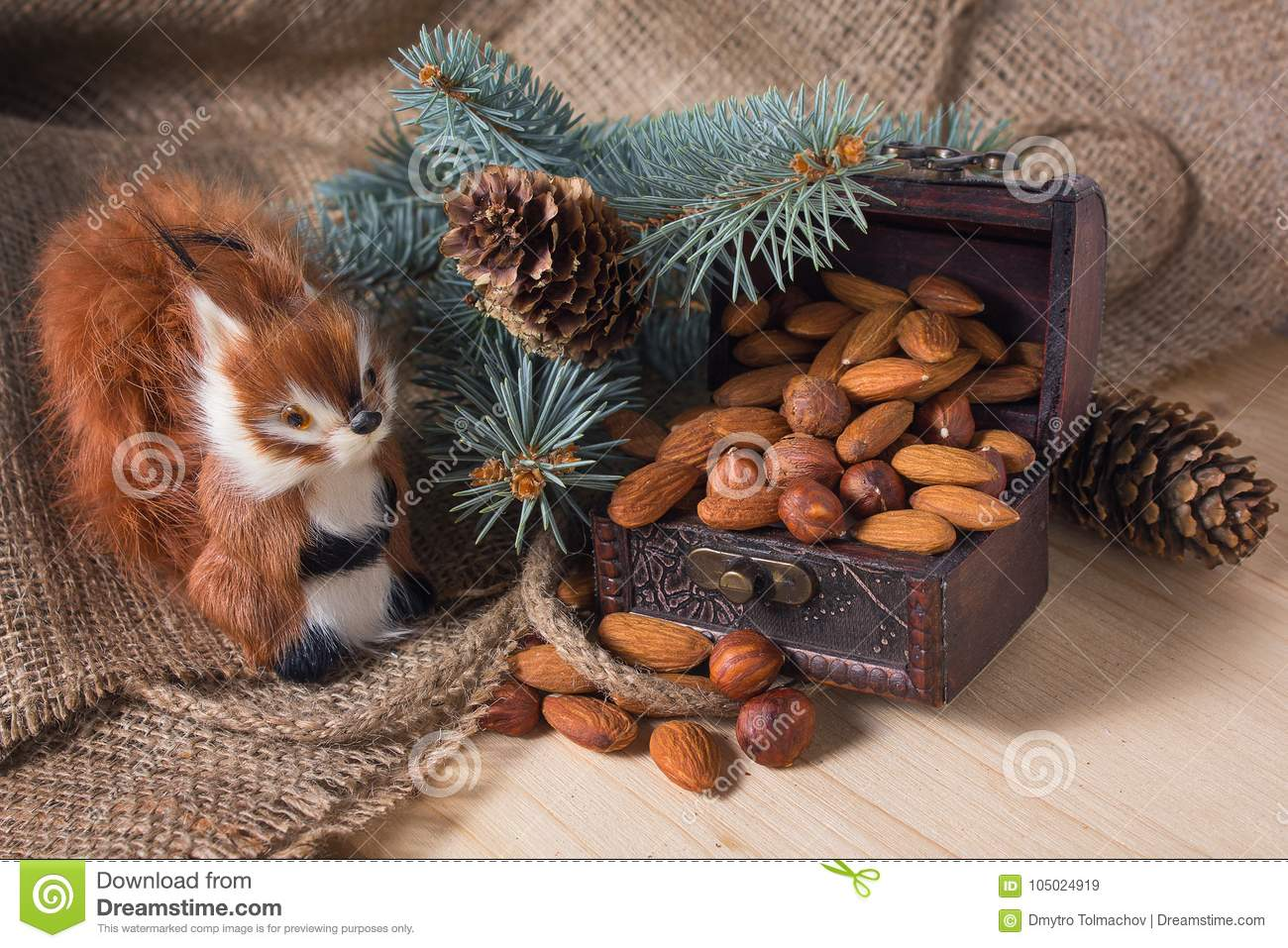 Toy squirrel and chest with nuts under the Christmas tree