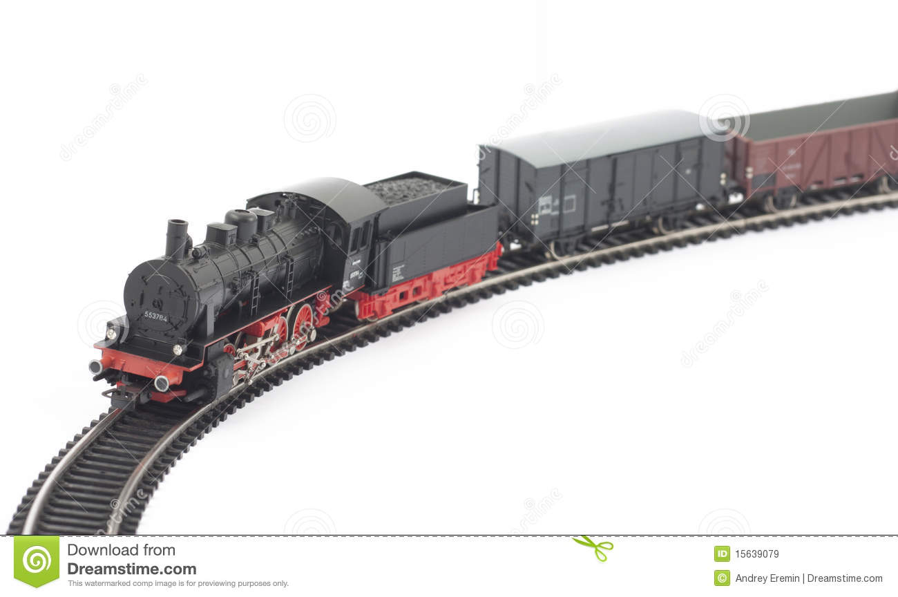 Toy steam locomotive and freight cars on white