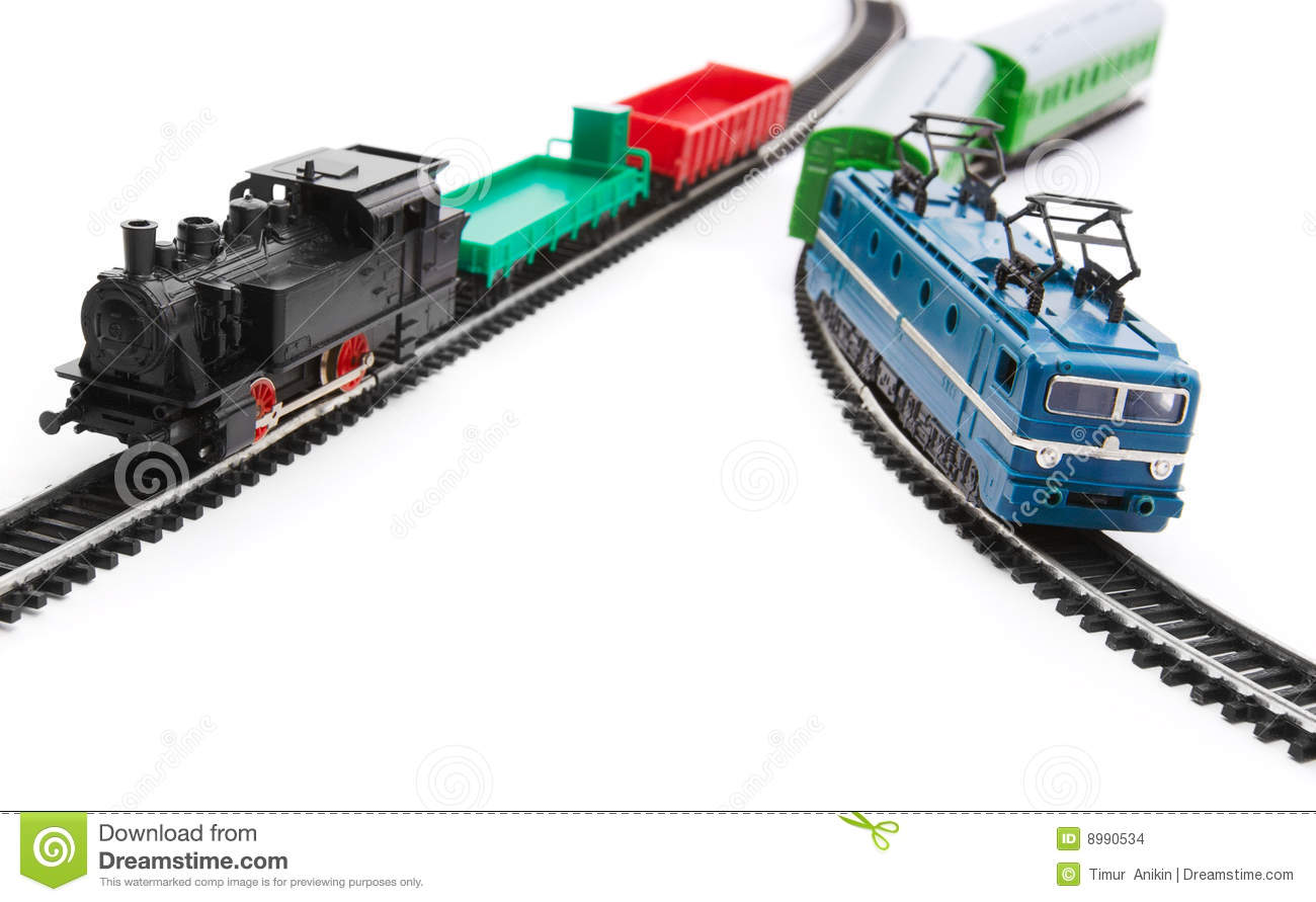 Toy trains and railroad isolated on white background.