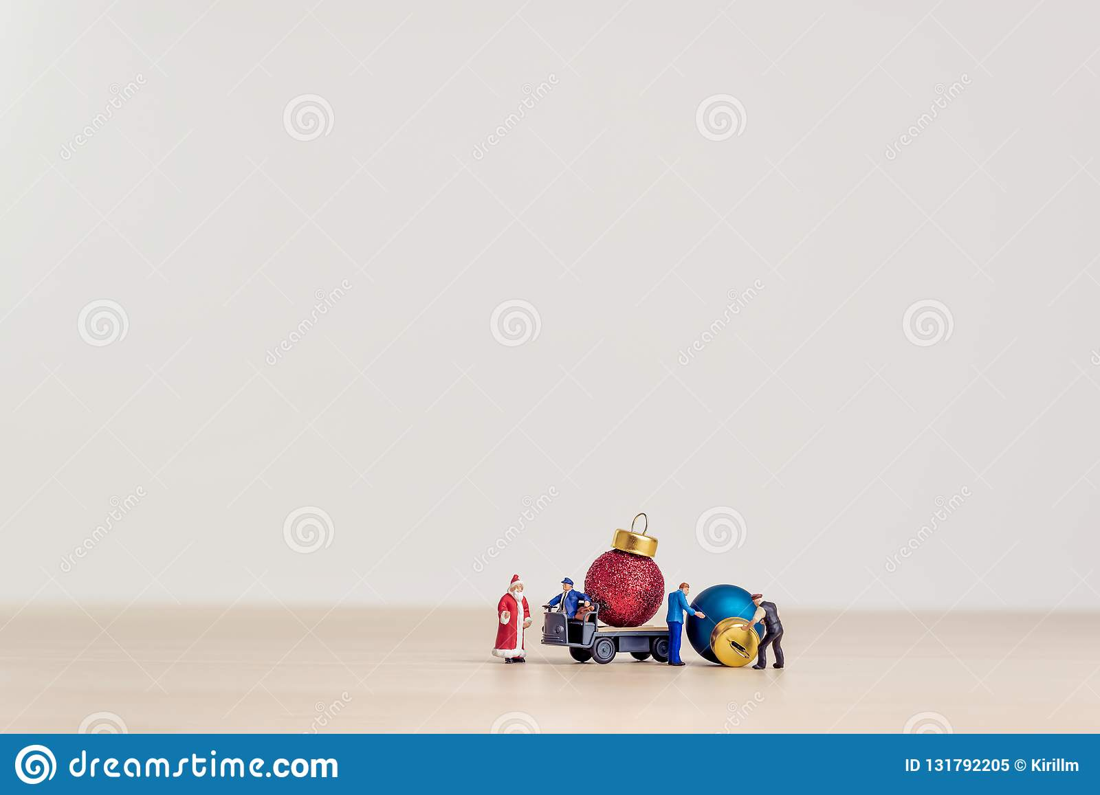Toy truck carrying Christmas decorative balls. Christmas concept with copy space