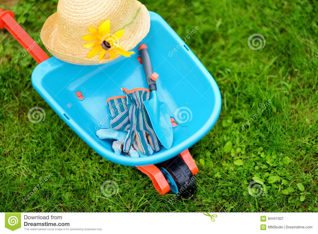 Toy Wheelbarrow, Childrens Garden Gloves And Garden Tools. Cute Toys For  Outdoor Gardening Game.