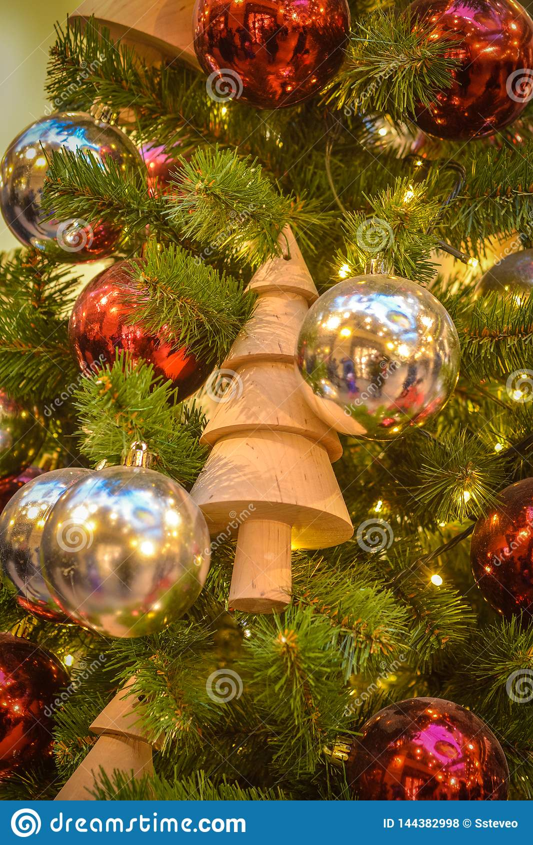 Toy - a wooden Christmas tree on a New Year tree