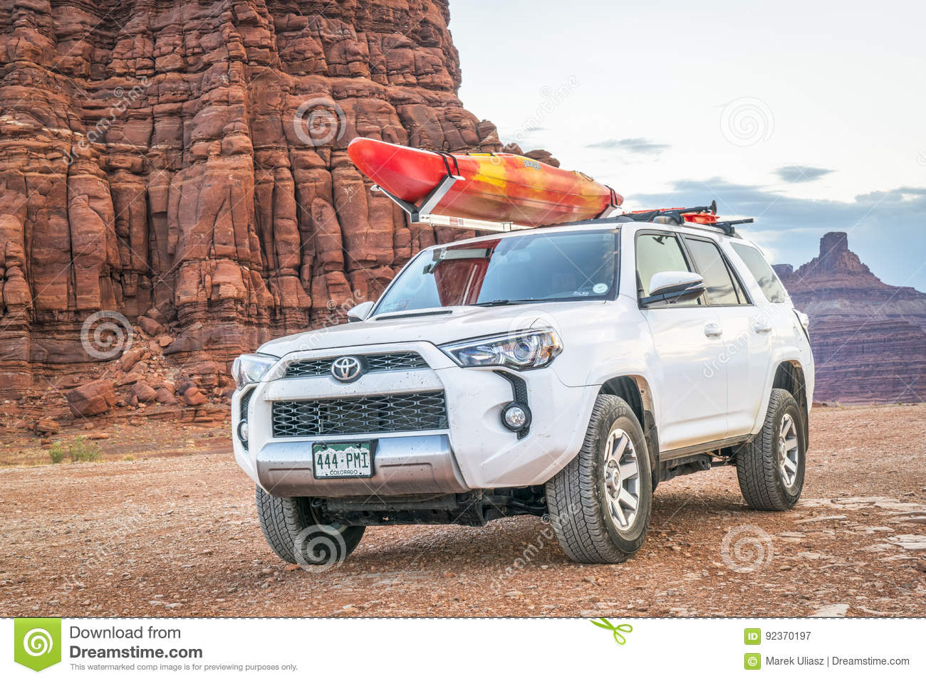 Toyota Suv With A Kayak On Roof On A Desert Trail