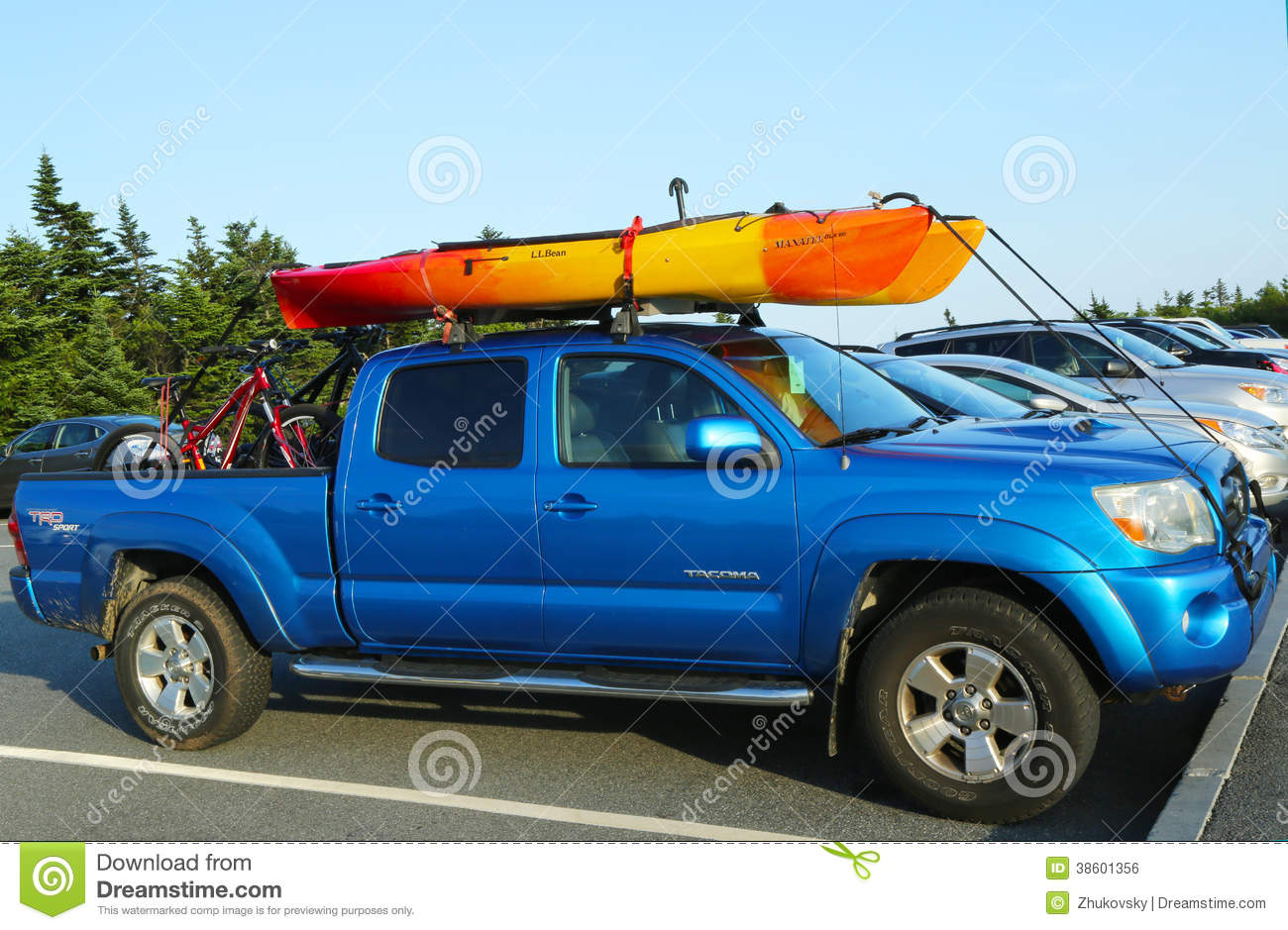 Toyota Tacoma Suv Loaded With Kayak And Bicycles Editorial