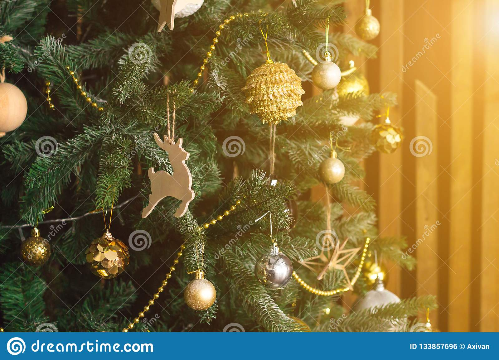 Toys On The Christmas Tree Golden Balls Deer Other Decorations New Year Theme Concept Sun Shining Orange Toned Stock Photo Image Of Winter Ornament 133857696