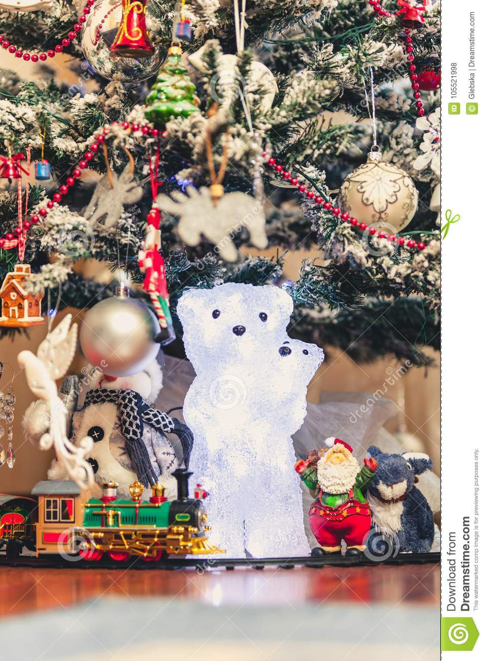 Figure Of Polar Bear With Bear Cub Under Christmas Tree Stock Photo