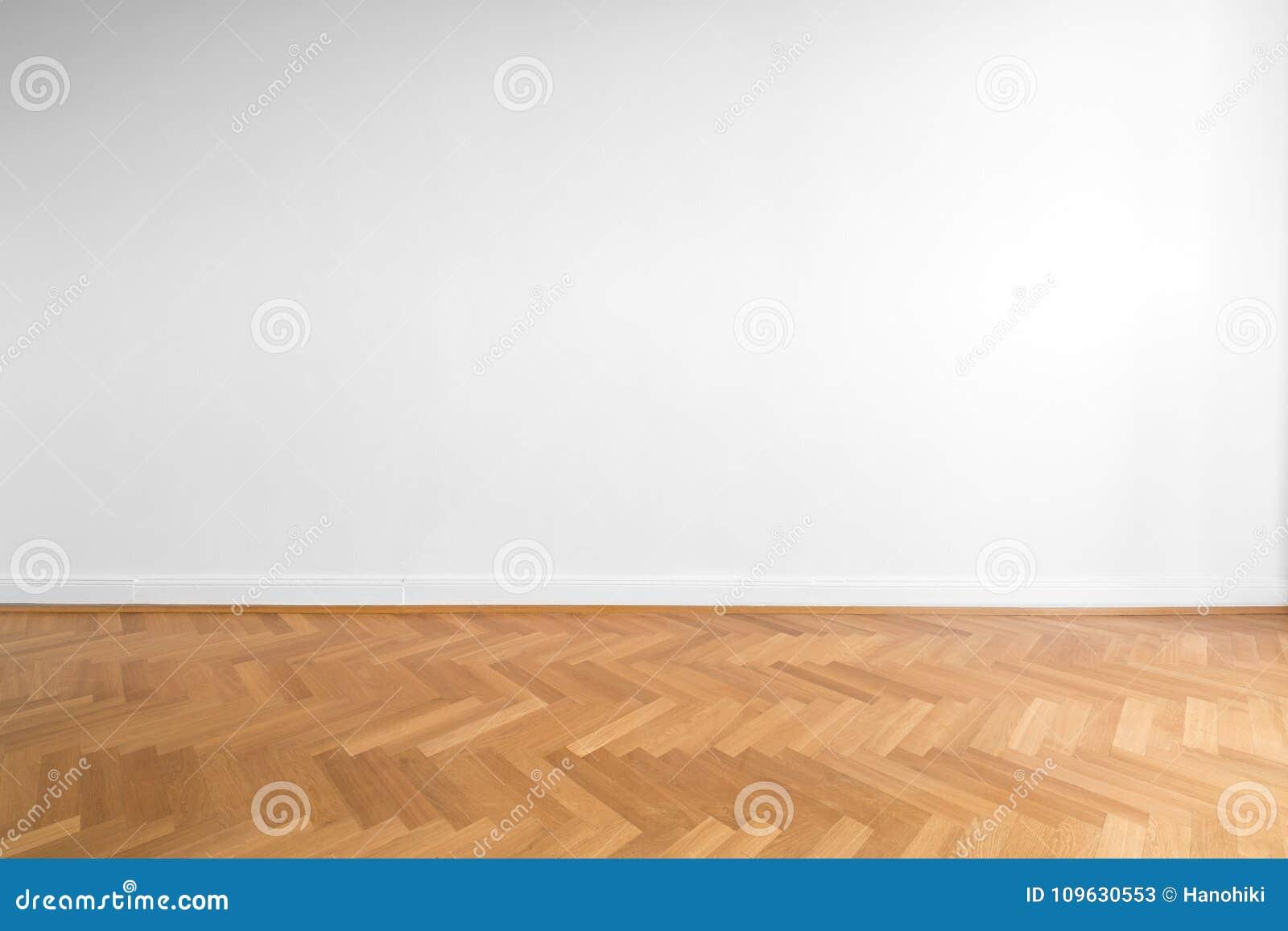 Träbakgrund för parkettgolvet och vitvägg- töm rum, ne