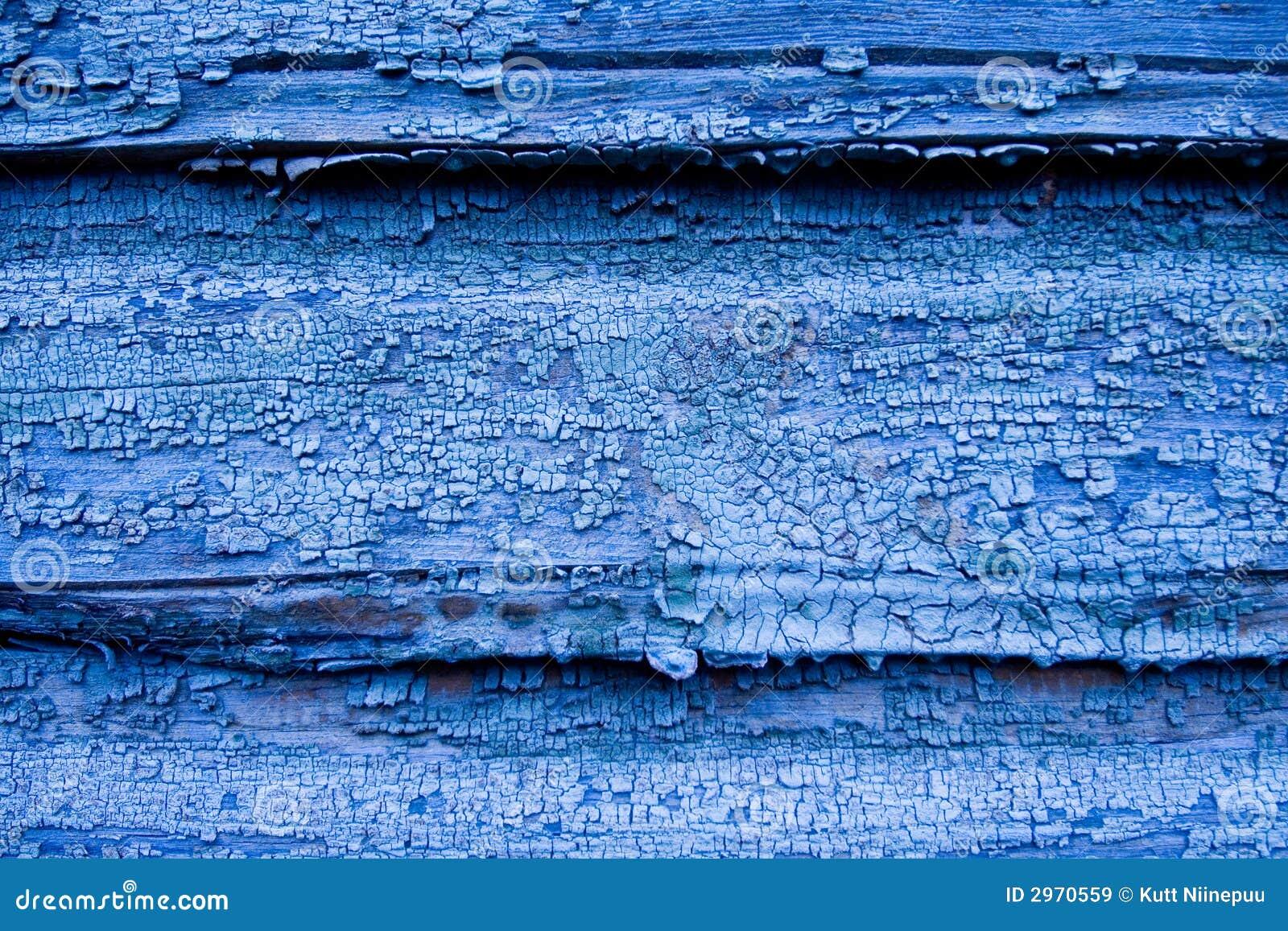 Träblå sprucken vägg
