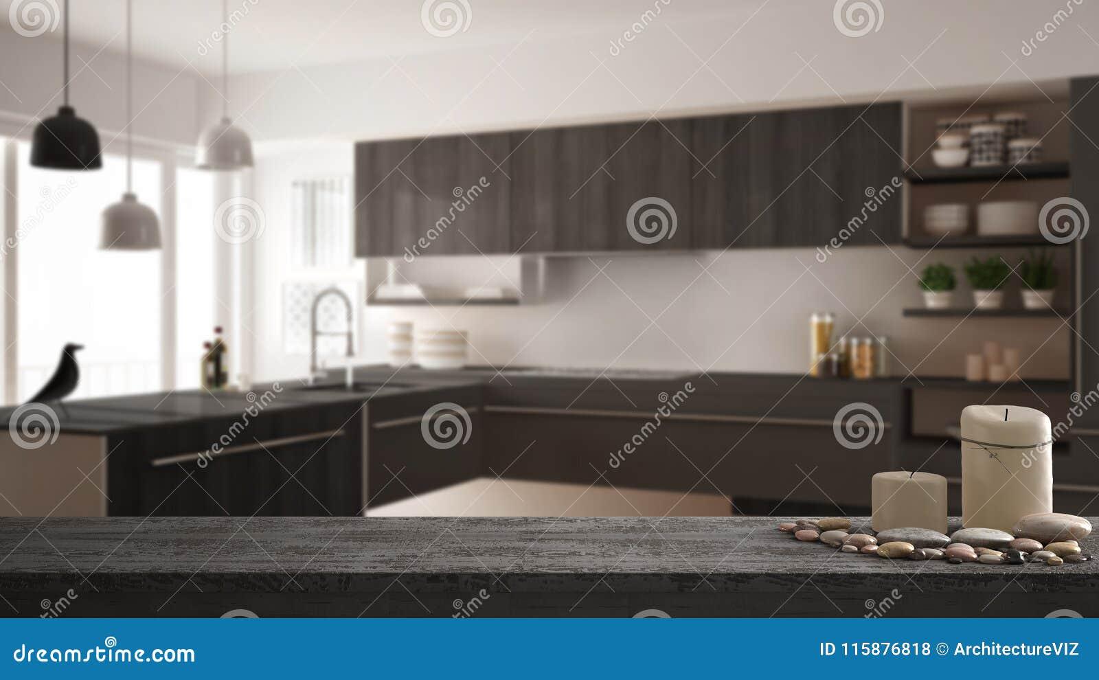 Trätappningtabellöverkant eller hylla med stearinljus och kiselstenar, zenlynne, över suddigt modernt minimalistic kök, grå arkit