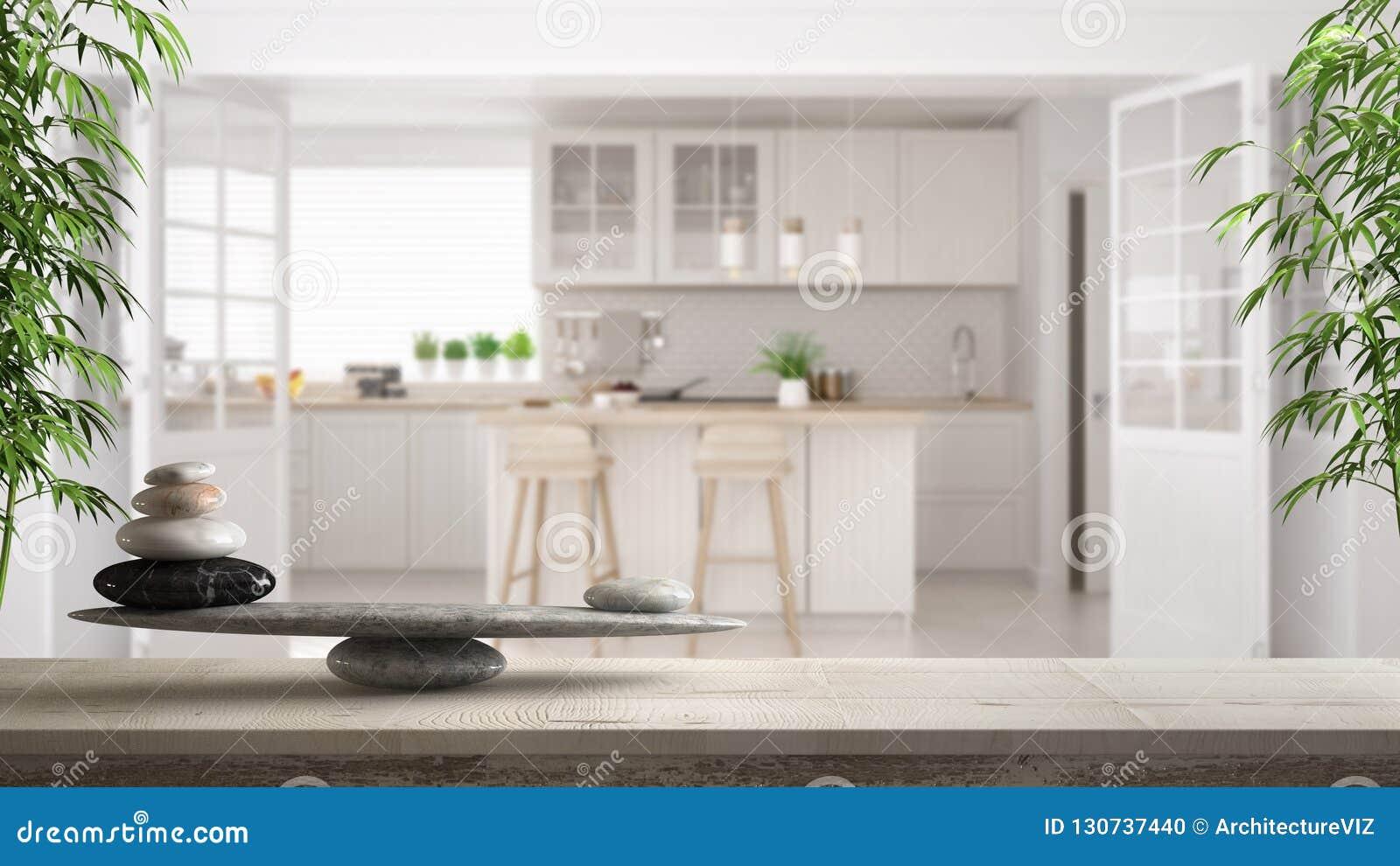 Trätappningtabell eller hylla med stenjämvikt, över suddigt scandinavian klassiskt vitt kök, fengshui, zenbegreppsarchitec