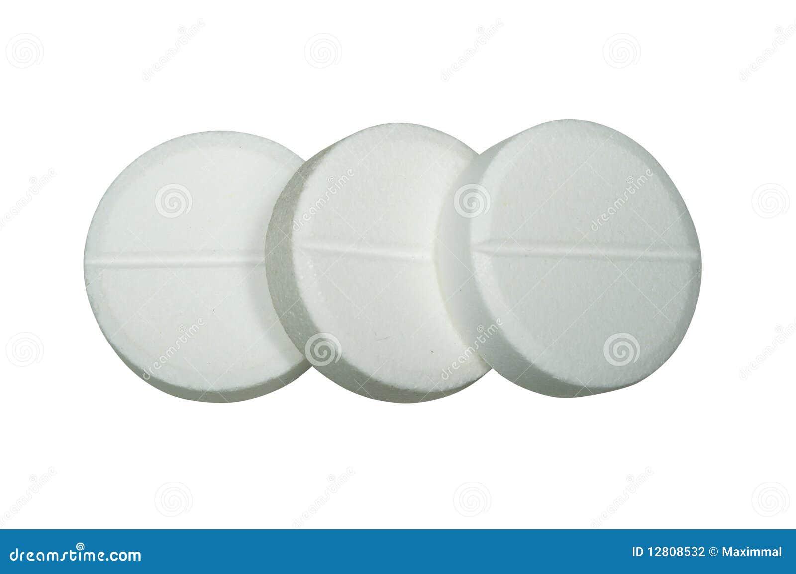 Três comprimidos brancos