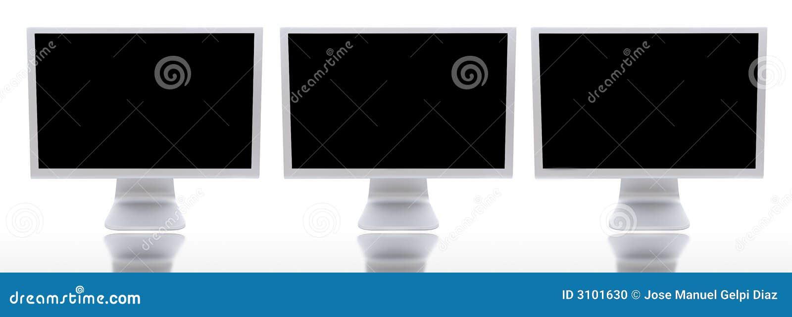 Três monitores dos computadores