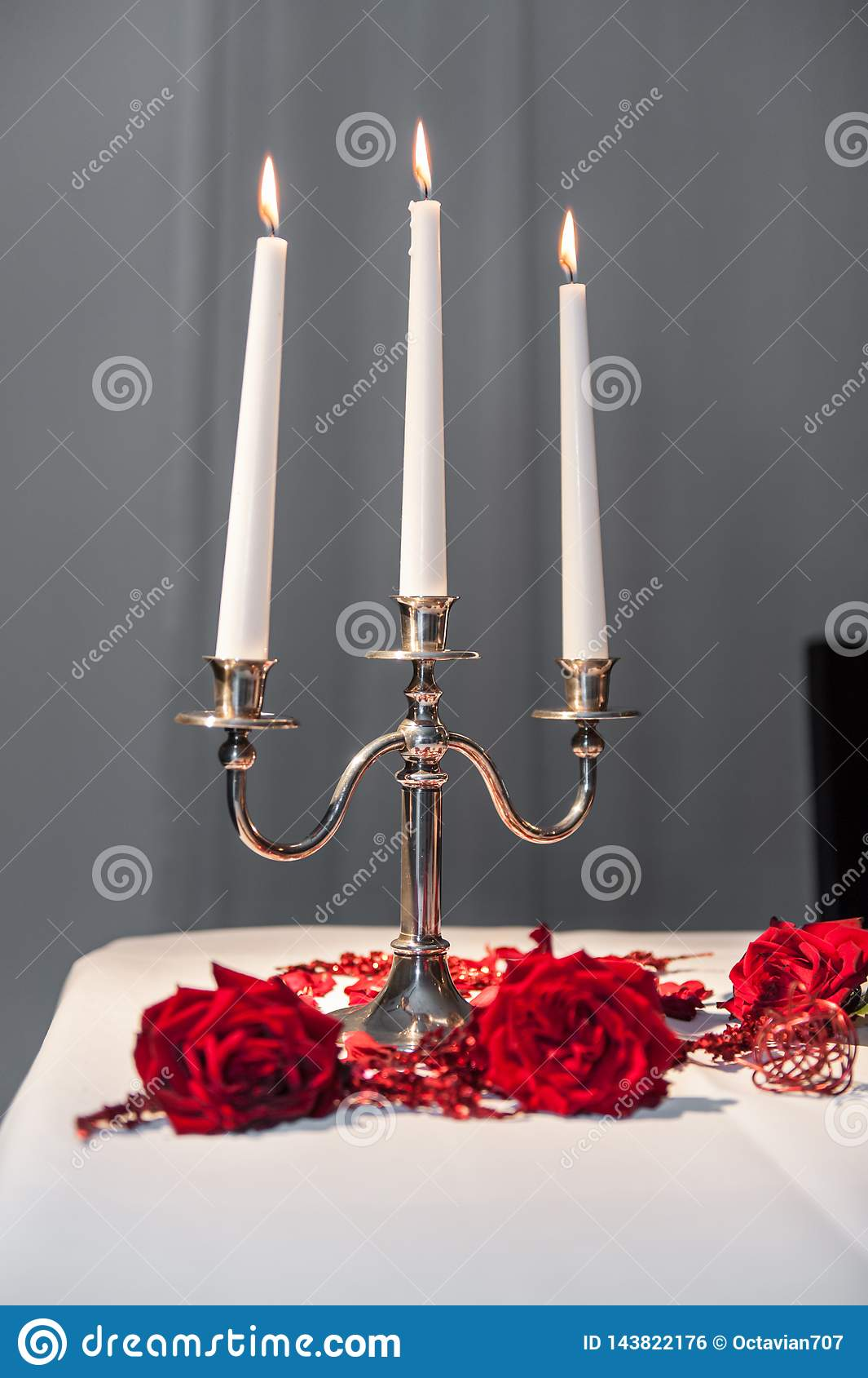 Três velas no castiçal