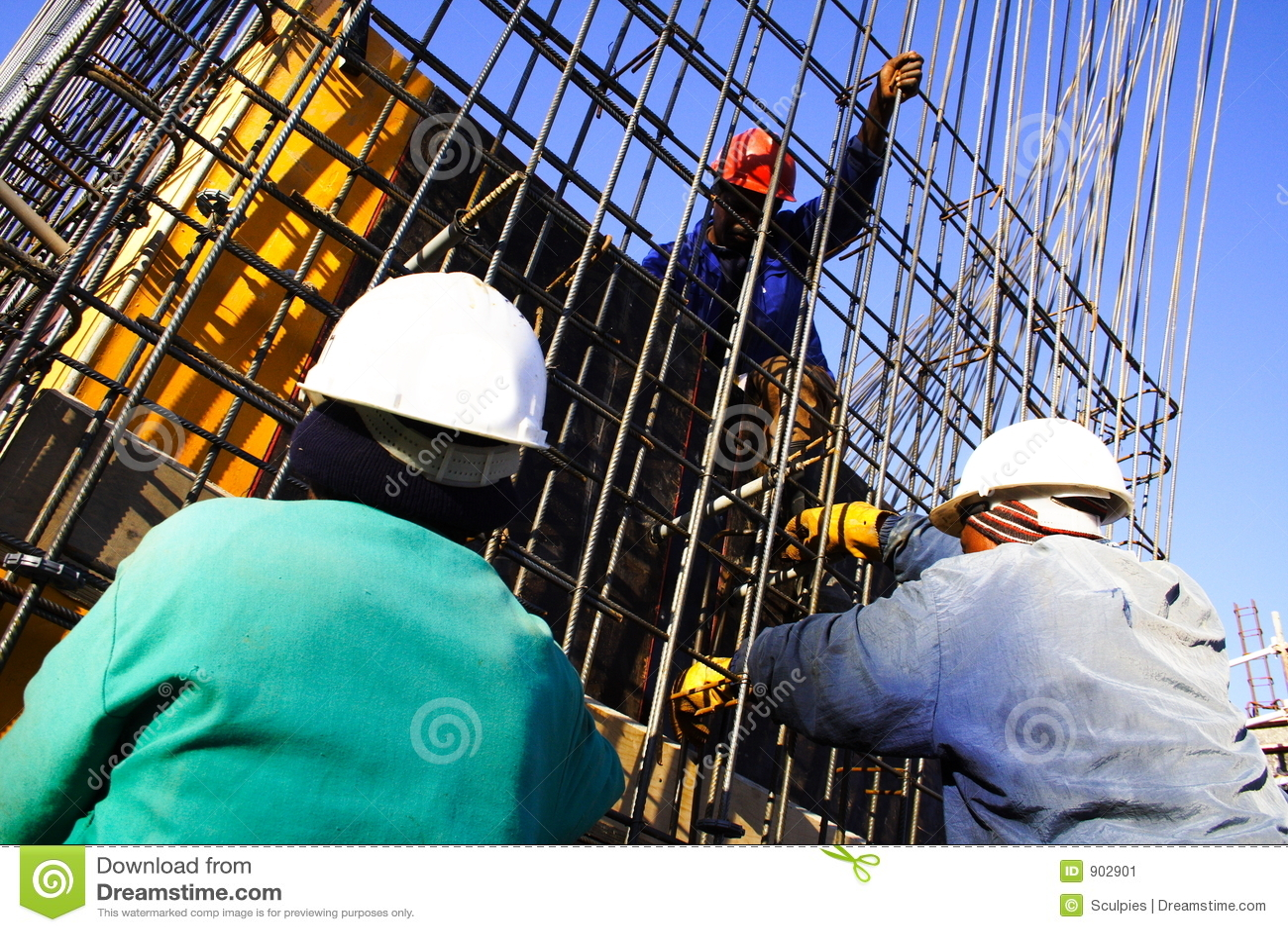 Trabajador De Construcción Tres Imagen de archivo - Imagen de azul ...