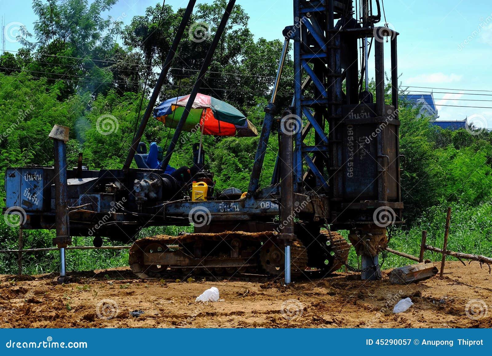 Trabajadores de construcción y conductor de pila