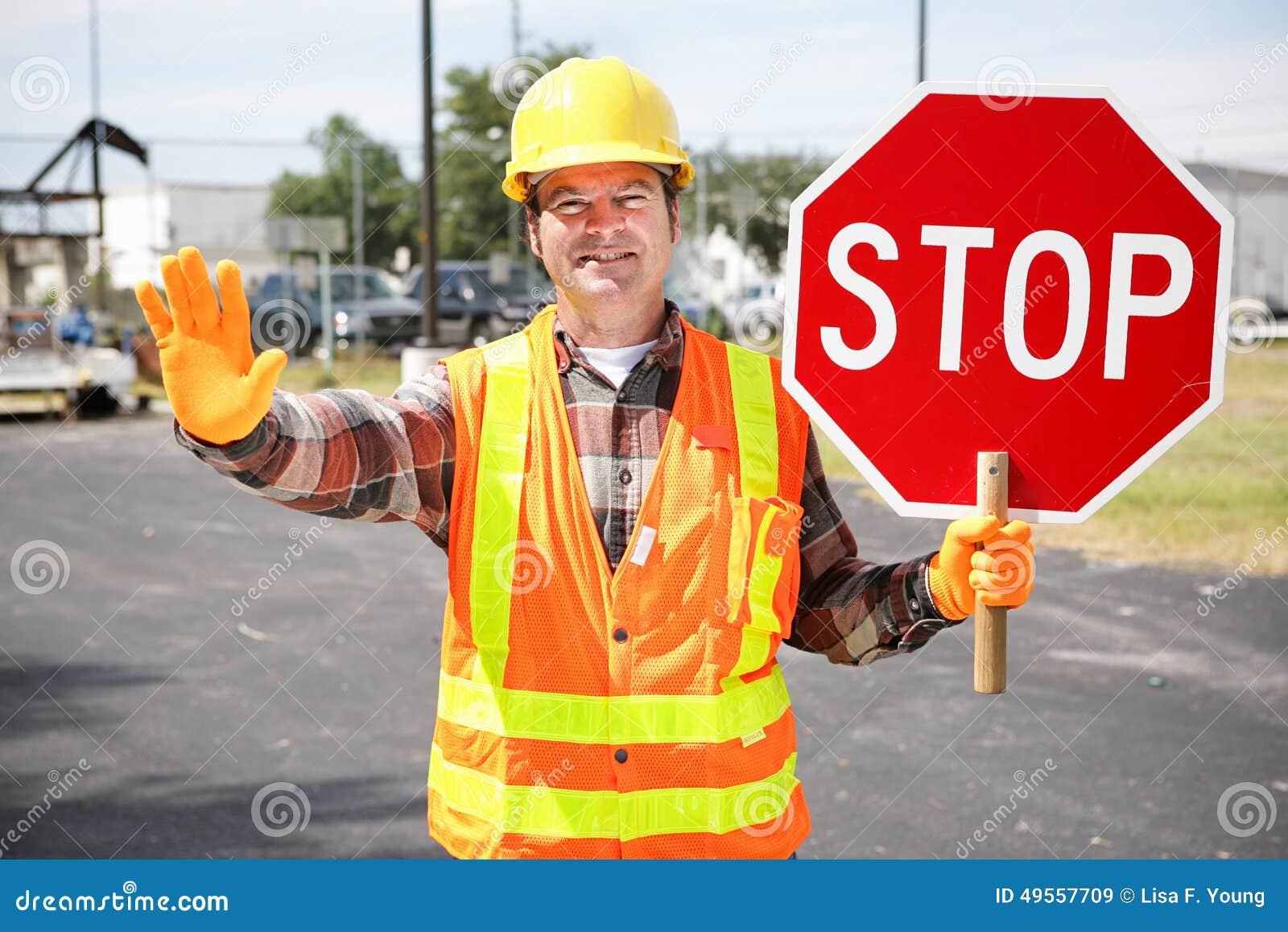 Trabalhador da construção com sinal do batente