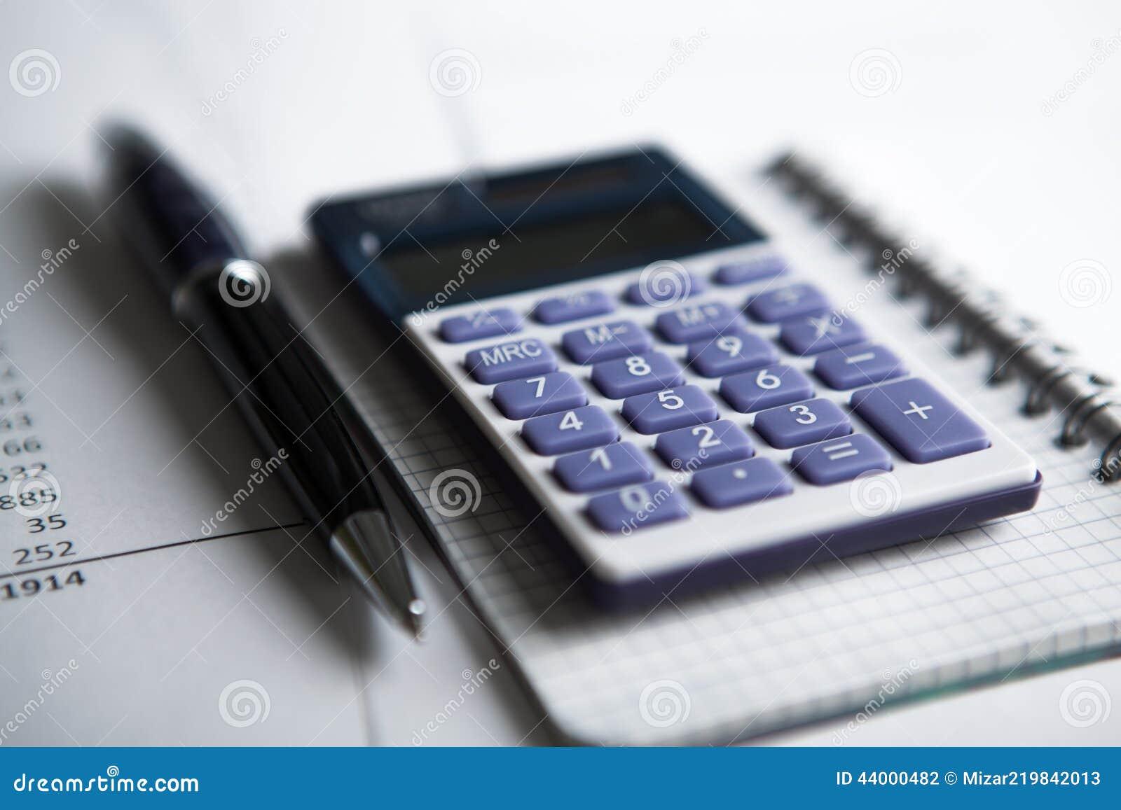 Trabalho na calculadora e nos papéis
